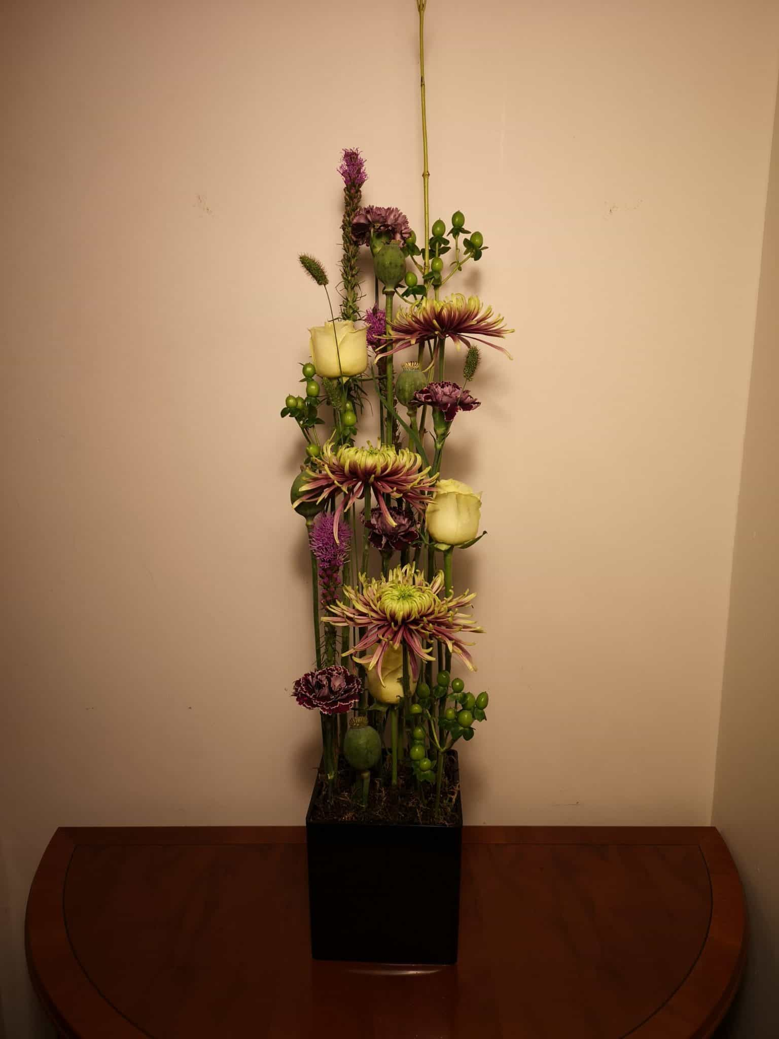 Parallel design flower arrangement purple